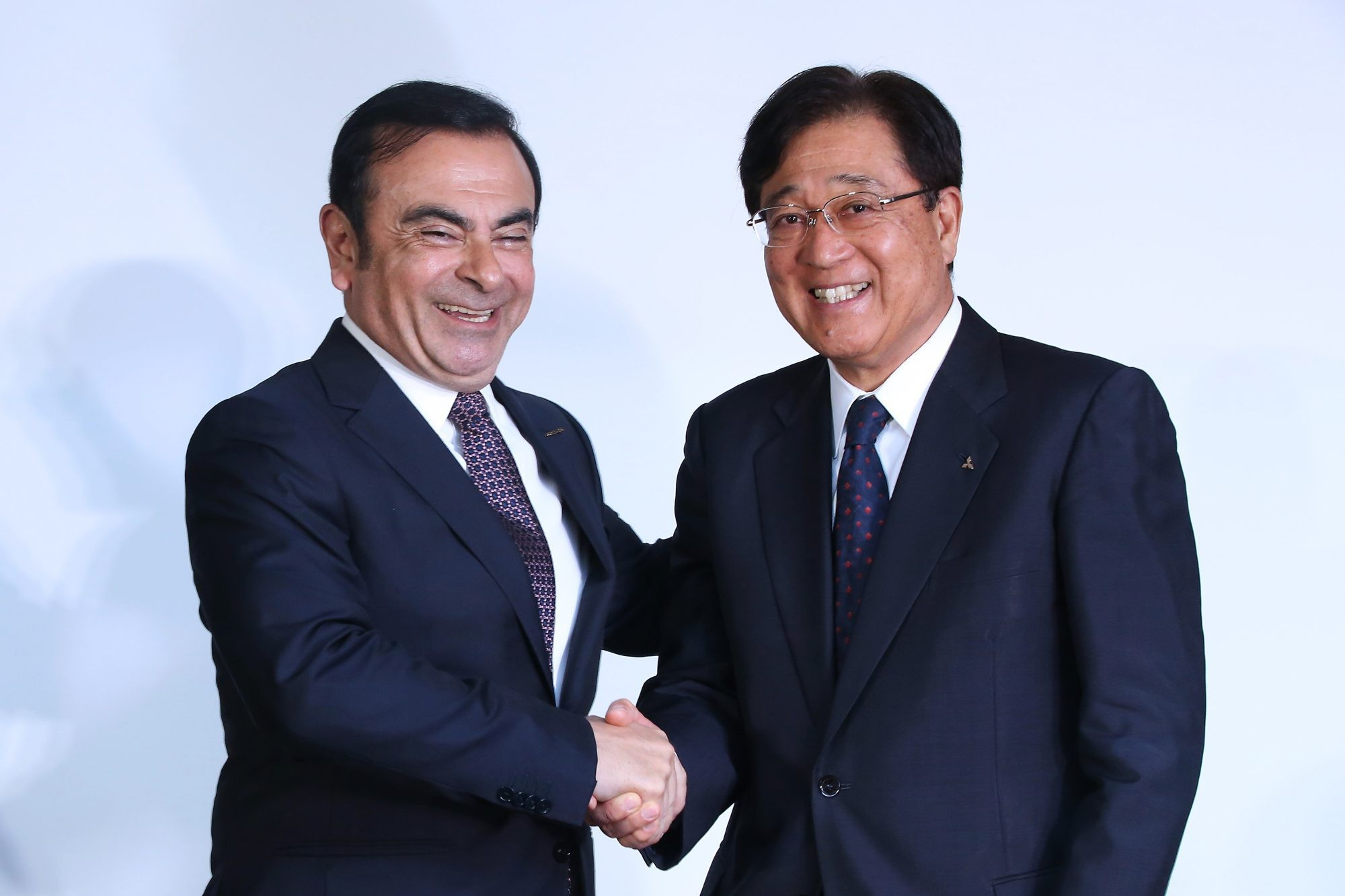 Nissan Motor CEO Carlos Ghosn And Mitsubishi Motors Chairman And CEO Osamu Masuko Attend News Conference