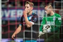 PSV speler Luuk de Jong (L) en Sparta keeper Roy Kortsmit tijdens de wedstrijd in de KNVB Beker. © ANP